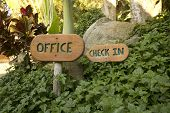 Tropical resort with office check in sign