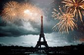 Eiffel tower with fireworks, celebration of the New Year in Paris, France poster