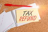 Handwriting Text Tax Refund. Concept Meaning Refund On Tax When The Tax Liability Is Less Than The T poster