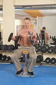 man in his forties exercising in gym