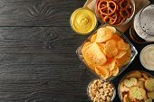 Beer Snacks, Glass Of Beer, Potato Chips, Beer Nuts, Sauces, Glass Of Beer On Wooden Background, Spa poster