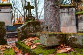Stone Cross In The Most Famous Cemetery Of Paris Pere Lachaise, France. Tombs Of Various Famous Peop poster