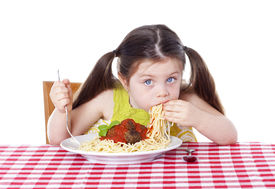 picture of table manners  - Beautiful girl eating pasta and meatballs with hands - JPG