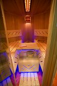 stock photo of hot water  - classic wooden dry sauna inside with accessories - JPG