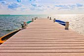 stock photo of mile  - Long boat dock in the Cayman Islands - JPG