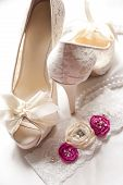 foto of garter  - Bridal shoes and lace garter close up - JPG