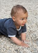 Child in pebbles