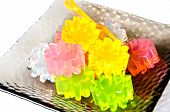 image of unnatural  - closeup of gelatin of different colors on a dish - JPG