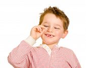 foto of cheeky  - Child checking out his lost tooth isolated on white - JPG