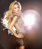 stock photo of showgirl  - Fashionable portrait of beautiful sexy woman dancing in shining dress - JPG