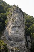 stock photo of decebal  - Statue of the Dacian king Decebal sculpted in rock - JPG