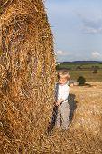 Little Boy On Goden Hay Field