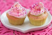 Two Cupcake On White Heart Shaped Plate, On Pink Background