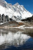 view of southern face of lhotse and nuptse mirroring on the lake on the way to everest base camp - n