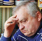 Portrait Of Sad Elderly Man