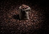 Coffee bag on coffee beans surface