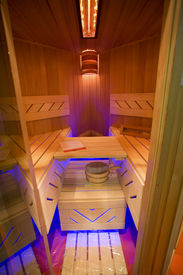 picture of hot water  - classic wooden dry sauna inside with accessories - JPG