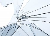 picture of fragmentation  - Broken glass fragments above white - JPG