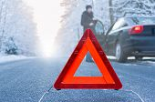 stock photo of towing  - Car breakdown on a country road in winter - JPG