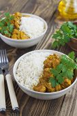 image of curry chicken  - Chicken curry with rice in a bowl on the table - JPG