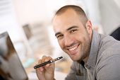 stock photo of electronic cigarette  - Portrait of cheerful guy smoking with e - JPG