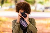 Autumn Outdoor Portrait Of Beautiful African American Young Woman Holding A Digital Camera - Black P