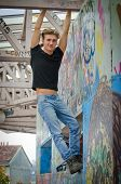 Handsome Blond Young Man Hanging From Concrete Structure