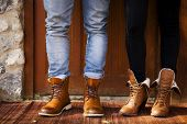 stock photo of boot  - Boy and girl with fashion leather boots - JPG