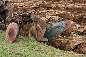 stock photo of plowed field  - plowing the field with an old plow - JPG