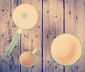 stock photo of saucepan  - Old cups and saucepan in a retro kitchen table setting filtered - JPG