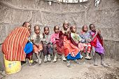 AFRICA, TANZANIA-FEBRUARY 9, 2014: African Kids of Masai  tribe village smiling to the camera and pl