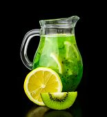 Drink With Kiwi And Lemon In A Glass Jug