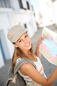 Tourist girl holding city map