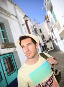 Man with backpack visiting Ibiza town