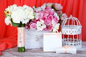 Beautiful wedding composition with flowers on table on fabric background