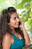 Young Latino Lady Talking On Cell Phone