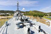 picture of battleship  - The battleship in the garden and blue sky - JPG