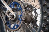 stock photo of motocross  - Close up fragment of rear sport motocross bike wheel - JPG