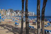 Benidorm, Costa Blanca, Spain - April 2014: Playa De Levante, Benidorm, Tourists on the beach.