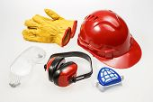 Protective construction work wear on a plain background