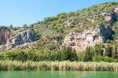 stock photo of dalyan  - Turkish Lycian tombs on the Dalyan River