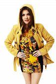 Attractive Woman In Yellow Coat