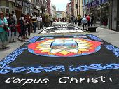 Passers-by admire Corpus Christi flower carpets in La Laguna, Tenerife, Canary Islands, Spain