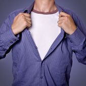 pic of open shirt breast showing  - Man pulling open shirt showing white t shirt - JPG