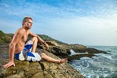Man Sitting Near Sea