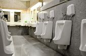 stock photo of urination  - Row automatic urinals in a modern toilet