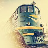 picture of locomotive  - diesel locomotive on railway station retro stylized - JPG