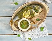 stock photo of sorrel  - baked dorado fish with sorrel pesto sauce - JPG