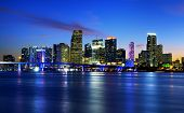 pic of skyscrapers  - Miami city skyline panorama at dusk with urban skyscrapers over sea with reflection