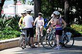 Cyclists in park, Malaga, Spain.